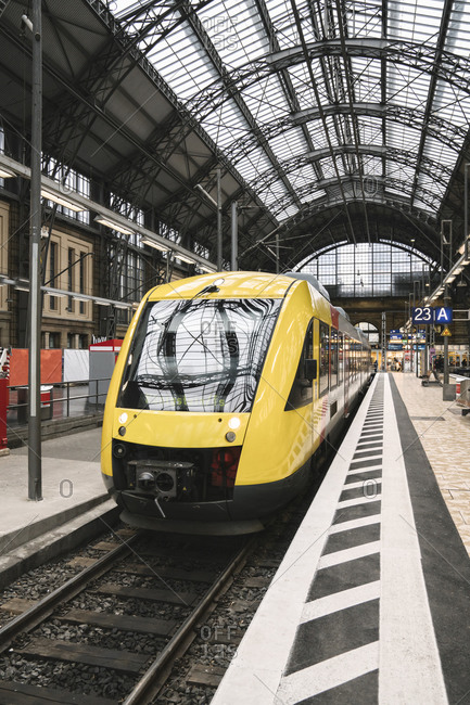 March 6, 2020: Germany- Hesse- Frankfurt- Yellow train waiting at train station