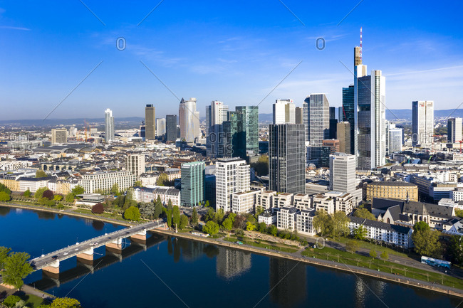 April 16, 2020: Germany- Hesse- Frankfurt- Helicopter view of bridge over river Main and downtown skyscrapers