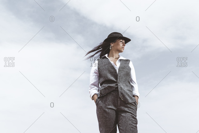 Fashionable young woman standing against sky looking at distance- Morocco