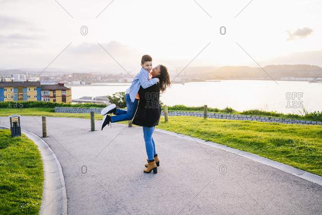 Happy young mother spending time with her son in the evening