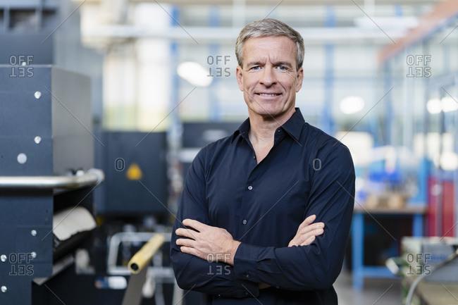 Successful entrepreneur in his company- portrait
