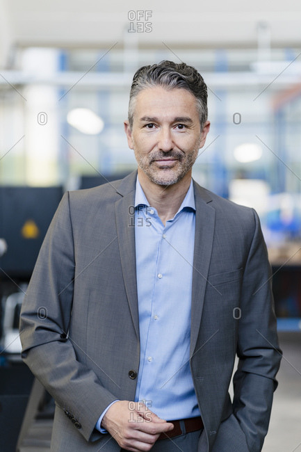 Portrait of successful businessman in shop floor of company