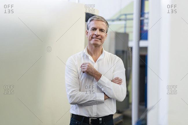 Competent businessman working in his company- portrait