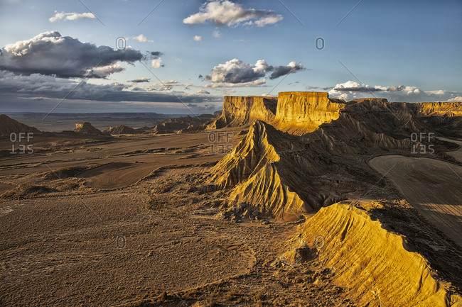 Spain- Navarre- Arid landscape of Bardenas Reales at dusk