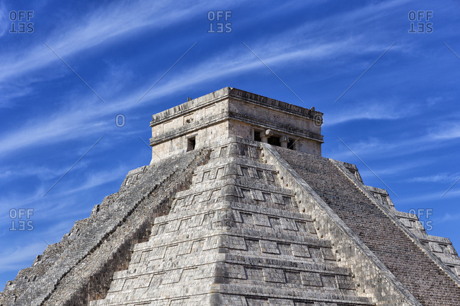 Mayan pyramid of Kukulcan against blue sky at Chichen Itza- Mexico