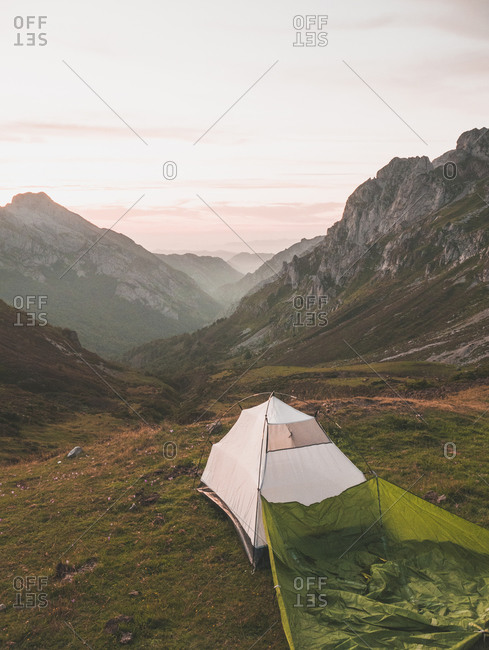Spain- Cantabria- White tent pitched in Picos de Europa at dawn