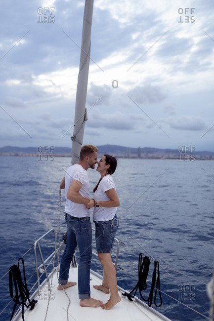 Couple kissing during sailing trip