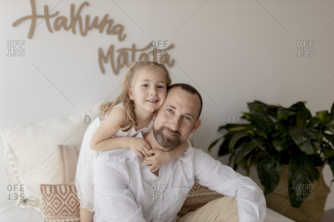 Portrait of happy father head to head with his daughter at home