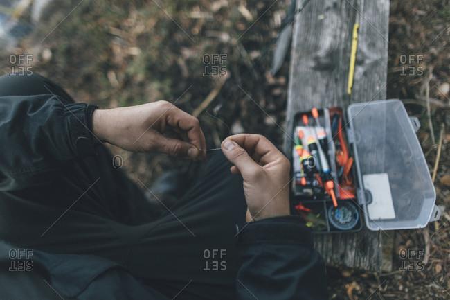 Man preparing fishing line- close up