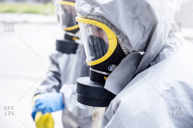 Cleaning staff disinfecting hospital against contagious virus- wearing protective clothing