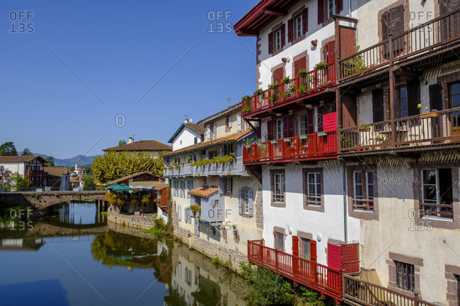 September 13, 2019: France- Pyrenees-Atlantiques- Saint-Jean-Pied-de-Port- Balconies of houses standing along Nive canal