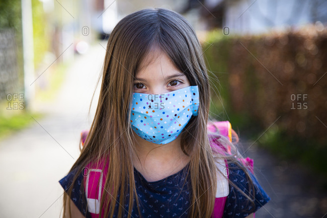 Girl wearing homemade protective mask