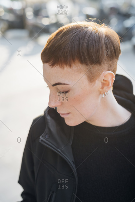 Portrait of redheaded young woman in the city