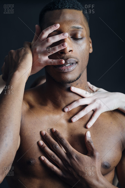 Woman's hands torching boyfriend's body in studio
