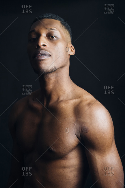 Studio portrait of nude young man posing