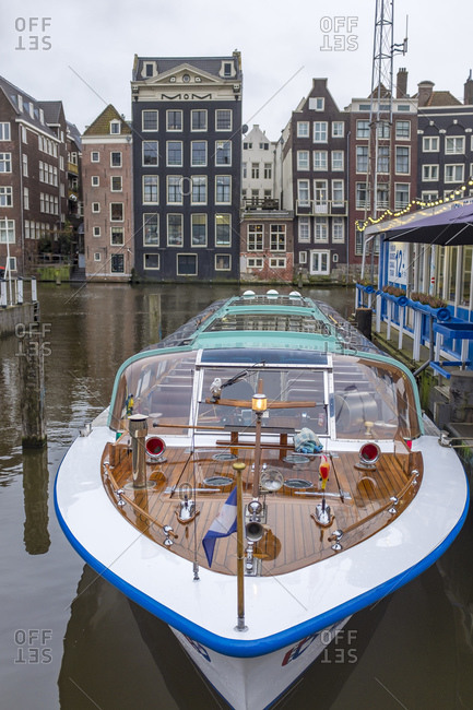 January 8, 2020: Netherlands- North Holland- Amsterdam- Tour boat moored along city canal