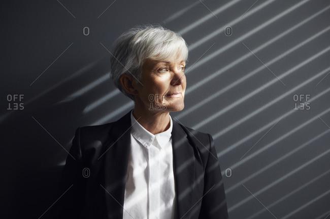 Portrait of pensive senior businesswoman looking at distance