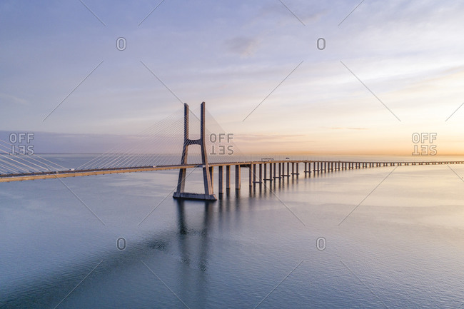Portugal- Lisbon- Vasco da Gama Bridge at moody sunrise