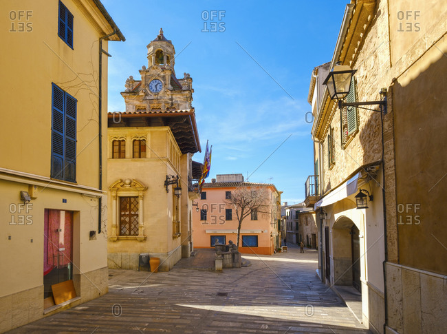 February 2, 2020: Spain- Balearic Islands- Mallorca- Alcudia- Old town street with town hall tower in background