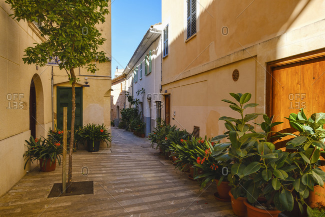 February 2, 2020: Spain- Balearic Islands- Mallorca- Alcudia- Old town alley decorated with potted plants