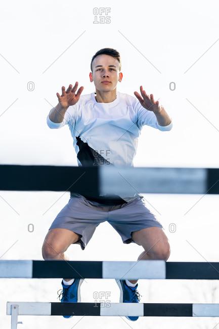 Athlete crossing a hurdle outside