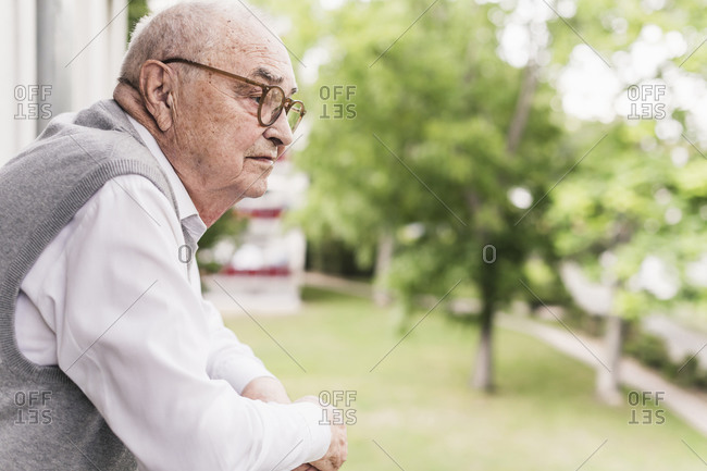 Senior man on balcony looking at distance