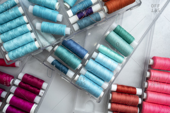 Colorful spools in plastic containers