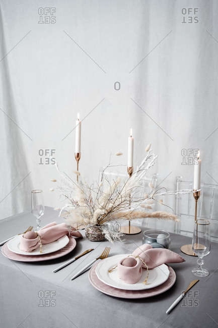 Setting Easter table with candles