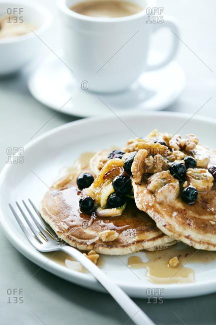 Blueberry Banana Walnut Pancakes with Syrup