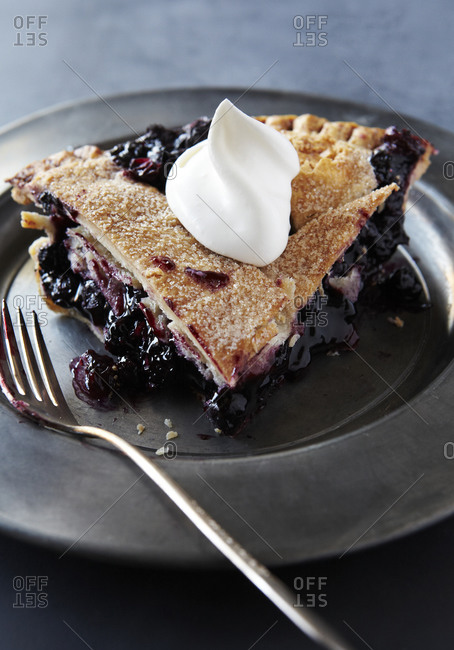 Slice of Blueberry Pie with Whip Cream