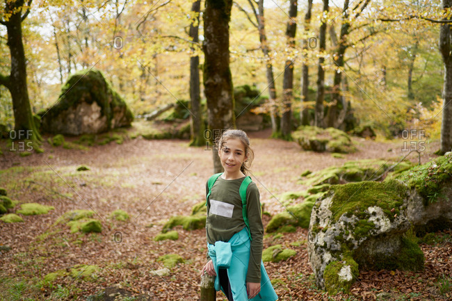 Girl walking through a beech forest
