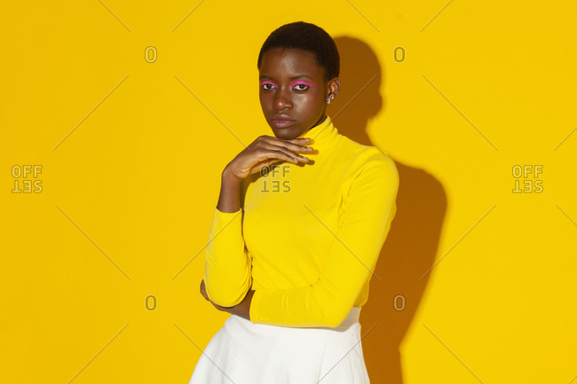 Young fashionable woman, total yellow style on yellow background