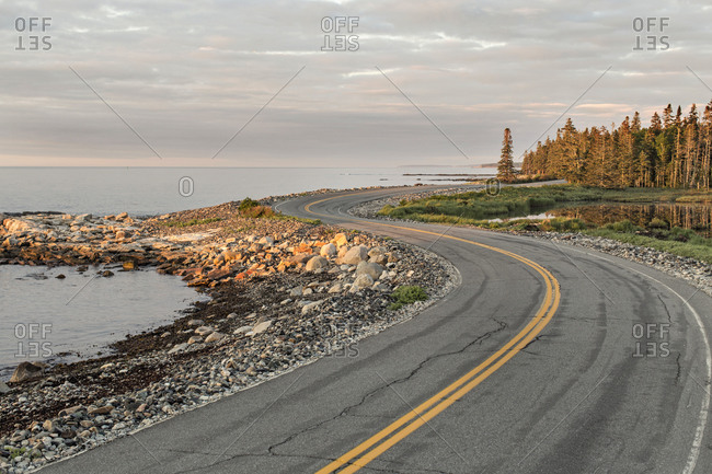 Twisting road winds along Maine Coast at sunrise, Acadia National Park
