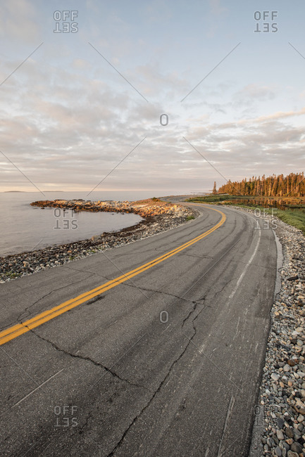 A road hugs the rugged coastline in Acadia National Park, Maine