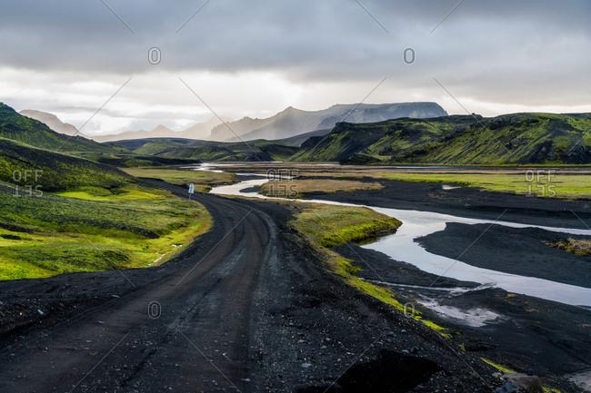 Black birthday road curve through Icelandic highlands landscape