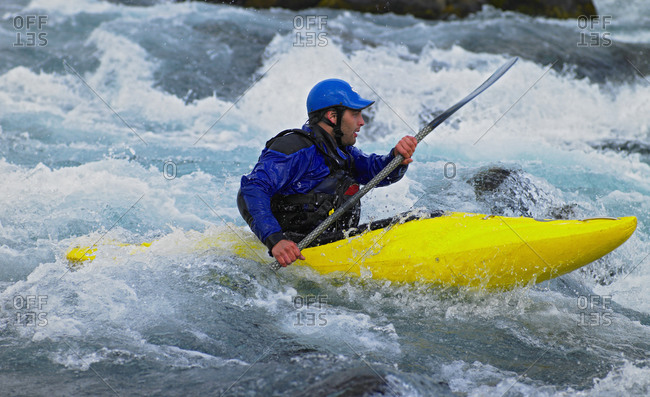 Man going on his white water kayak  rapids in an Icelandic river