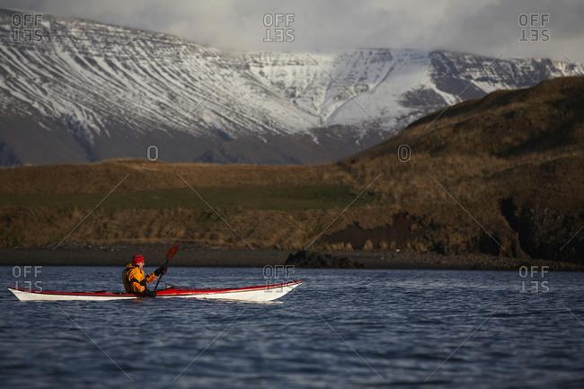 Mature man kayaking around Reykjavik