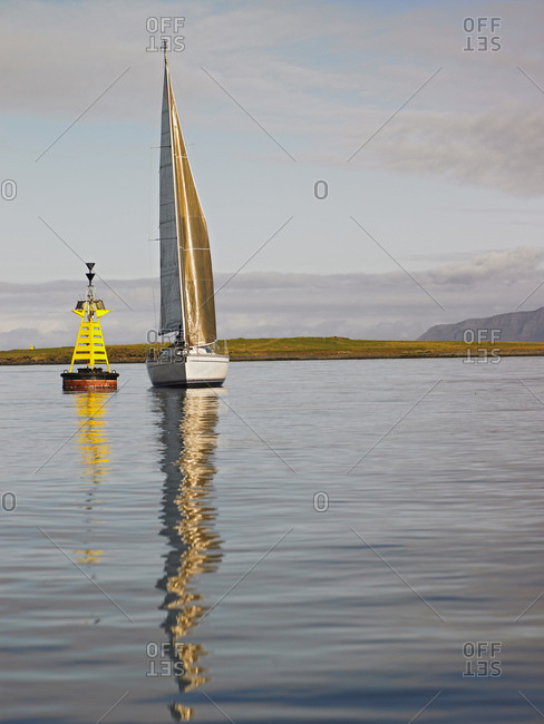Sailboat in calm weather close to Reykjavik