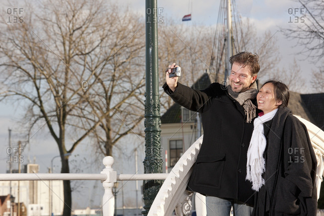 Mature couple taking selfie in Middelburg on a short vacation