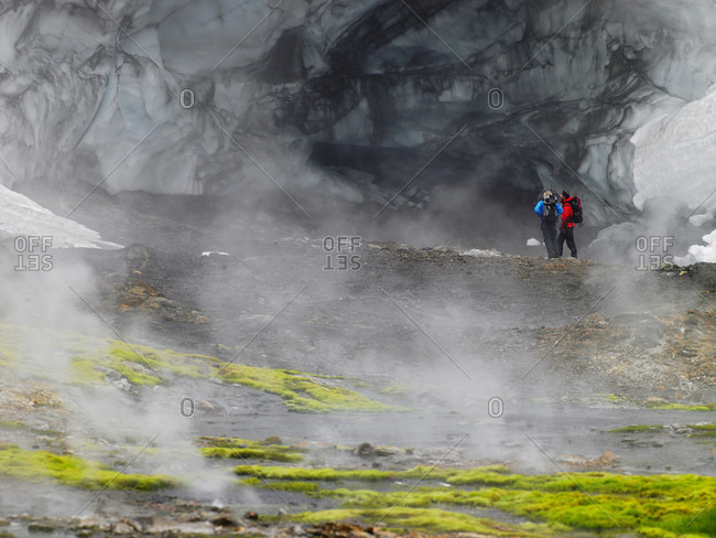 Couple exploring the glacier at Hrafntinnusker in Iceland