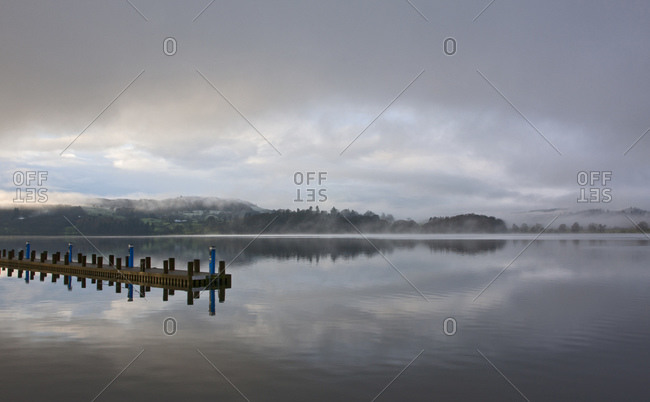 Pier at still lake in the British Lake District