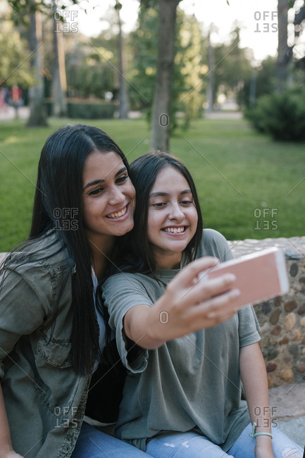 Teenagers taking a selfie in a park