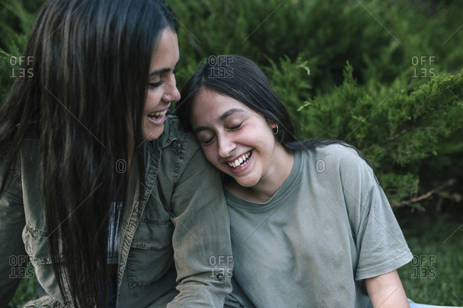 Teen girls laughing in a park