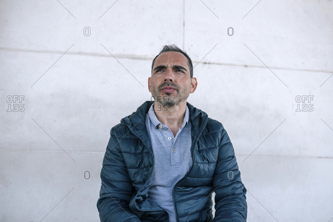 Portrait of a Caucasian man sitting on a bench