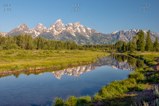 Morning view of the Grand Teton mountains and the Snake River In Grand Teton National Park, Wyoming, USA