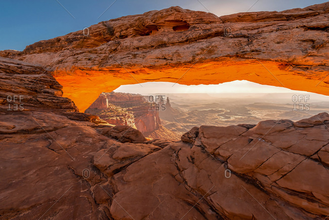 Early morning view of Mesa Arch with sunrise light reflecting from below in Canyonlands National Park.