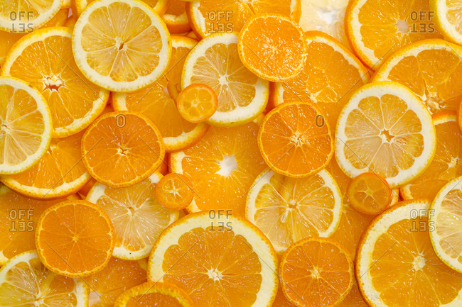 Full frame shot of vibrant sliced oranges and lemons