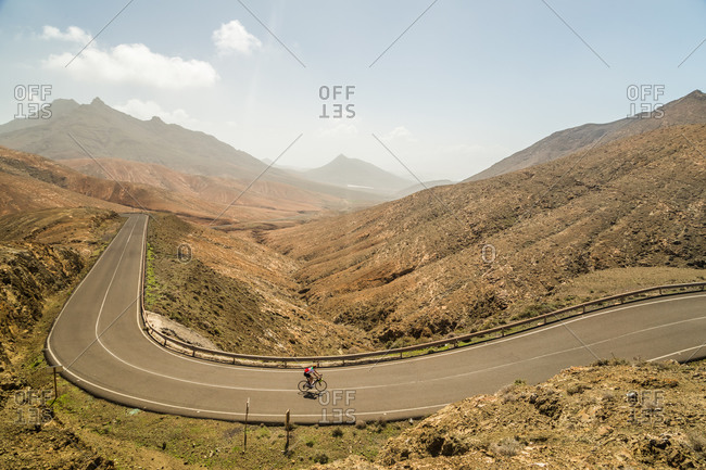 FUERTEVENTURA, SPAIN - 1 MARCH 2018: Panoramic view of winding road and cyclist viewpoint of Sicasumbre, Fuerteventura.