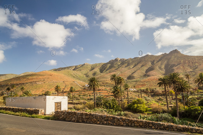 Rural house ad dry landscape hills behind in Fuerteventura, Canary Islands, Spain.