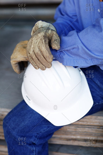 Close up of a male construction foreman holding a hard hat